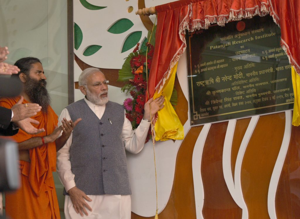 The Prime Minister, Mr Narendra Modi unveiling plaque to mark inauguration of Patanjali Research Institute, at Haridwar, in Uttarakhand on May 03, 2017.