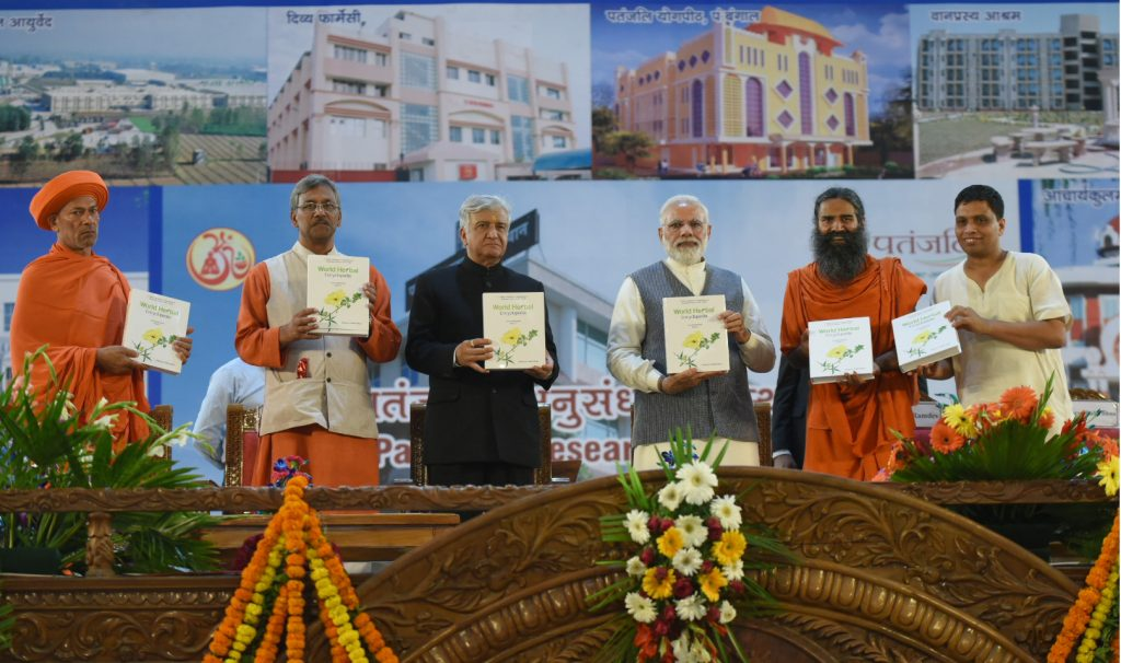 The Prime Minister, Mr Narendra Modi releasing the World Herbal Encyclopedia, Vol. 01, at the inauguration ceremony of the Patanjali Research Institute, at Haridwar, Uttarakhand on May 03, 2017. The Governor of Uttarakhand, Dr Krishan Kant Paul, the Chief Minister of Uttarakhand, Mr Trivendra Singh Rawat and the Yoga Guru, Baba Ramdev are also seen.